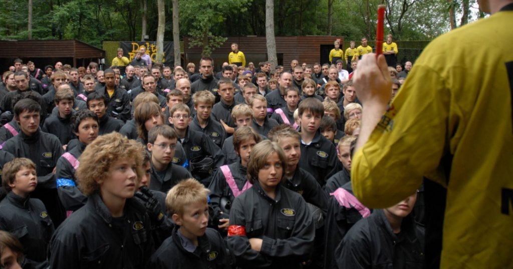 Children paying attention to a Paintball safety brief